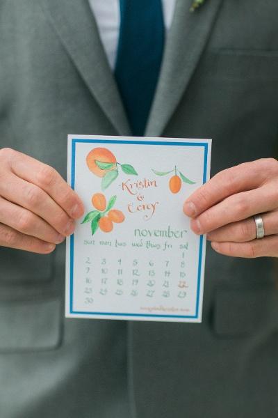 Groom holding invitation